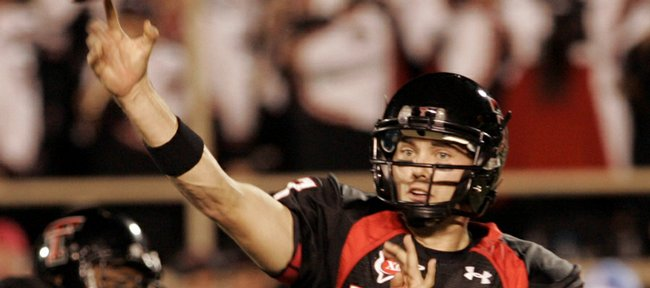 Texas Tech quarterback Seth Doege throws in the fourth quarter of the Red Raiders' 52-30 loss Saturday to Texas A&M. Reports surfaced this week that Doege will start today against Kansas..
