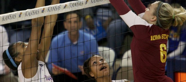 Kansas middle blocker Tayler Tolefree, left, battles Iowa State's Kylee Manns at the net during their match on Oct. 10 at the Horejsi Center. Tolefree is second on the team in blocks.