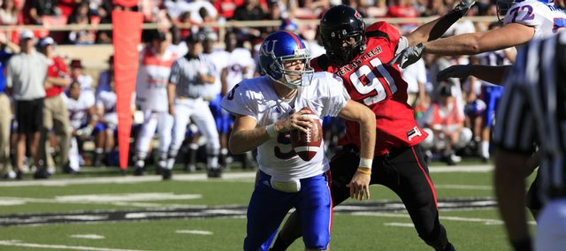 KU quarterback Todd Reesing scrambles away from pressure in the first half of Saturday's game against Texas Tech in Lubbock, Texas.