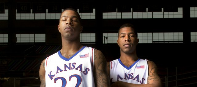 Kansas University forwards Marcus Morris, left, and Markieff Morris made the extra effort to hit the weights in the offseason. They have added muscle, they're more aggressive, and they're dunking with regularity, parts of their games that lacked at times last year.