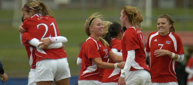 Kansas University players celebrate a goal by Emily Cressy (21) in the second half. Kansas defeated Missouri, 3-2, on Friday at Jayhawk Soccer Complex. The victory helped the Jayhawks qualify for the Big 12 tournament.