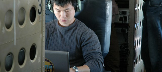 Lei Shi, Kansas University graduate student and research assistant, tweaks inputs to the Multi-channel Coherent Radar Depth Sounder, or MCoRDS, on the plane during a flight. KU researchers are stationed in Chile to help NASA gather more information on the world's polar ice.