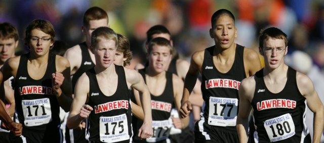 Members of the LHS cross country team Zach Andregg (171), Calvin Morgan (175), Simon Fangman (172), Joseph Springer (177), and Roy Wedge (180), run together at the start of the Class 6A Boys Kansas State cross country race on Saturday, Oct. 31, 2009, at Rim Rock Farm.