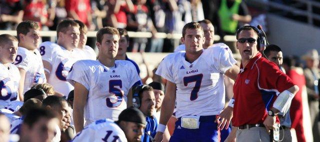 Kansas quarterbacks Todd Reesing and Kale Pick watch as the game winds down, finalizing the Jayhawks' loss at Jones AT&T Stadium in Lubbock, Texas, on Saturday, Oct. 31, 2009.