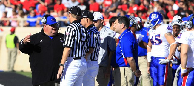 Coach Mark Mangino has a word with officials during KU's game against Texas Tech at Jones AT&T Stadium in Lubbock, Texas, on Saturday, Oct. 31, 2009.