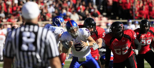 Kansas University quarterback  Todd Reesing (5) loses the ball after a big hit by Texas Tech's Daniel Howard. The Jayhawks lost four of five fumbles in a 42-21 loss to the Red Raiders on Saturday in Lubbock, Texas.