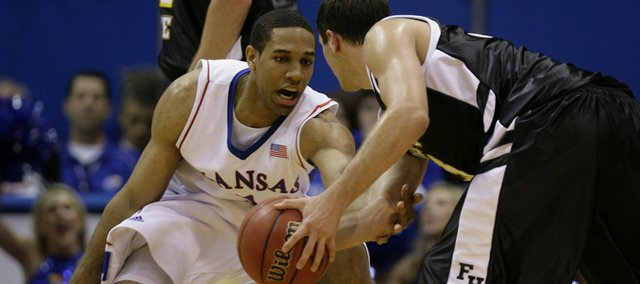 Kansas forward Xavier Henry takes a swipe at the ball, handled by Fort Hays State guard Corbin Kuntzsch during the first half of Tuesday's exhibition at Allen Fieldhouse.