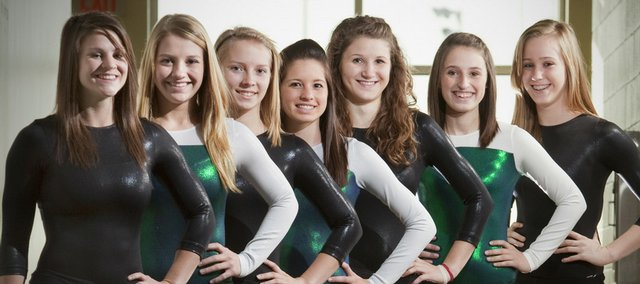 From left, senior Drue Davis, junior Kelcy Bowers, sophomore Jackie Soelter, junior Lexi Gonzales, senior Camille DuBos, junior Aly Frydman and freshman Brooke Leslie will try to lead the Free State High gymnastics team to a Class 6A state title on Saturday in Newton.