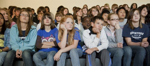 South Junior High students watch a video of an interview with a prison inmate as he describes the hardships and sadness of being in jail. The video was part of the Road to Freedom program Thursday, presented by Tom Bevard and his son, Randy, that incorporated rock music and messages of staying off drugs and alcohol and avoiding jail.