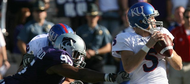 Kansas quarterback Todd Reesing was under pressure in the first half  of the Kansas and Kansas State game Saturday, Nov. 7, 2009 in Manhattan.