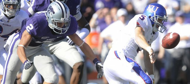 Kansas quarterback Todd Reesing coughs up the ball against Kansas State in Manhattan Saturday, November 7, 2009.