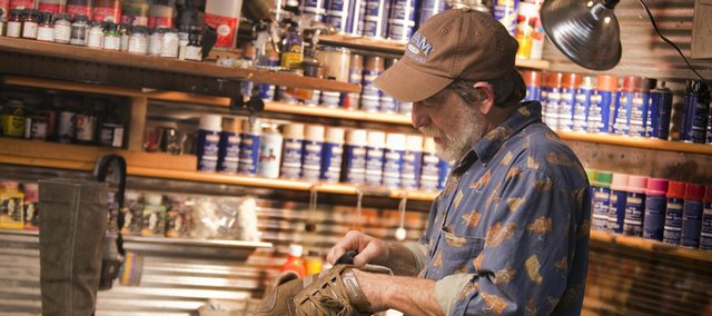 Bruce Barlow, owner of BKB Leather, 811 Elm St., works on cleaning a suede shoe in his shop. Barlow says suede is especially difficult to care for and requires more maintenance because it is inherently spongy, unlike smooth leathers. Still, paying for cleaning and repair often weighs out over replacing your shoewear.