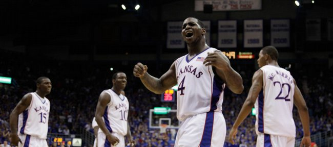 Kansas guard Sherron Collins calls the Allen Fieldhouse crowd from their seats after a dunk by Marcus Morris during the first half Tuesday, Nov. 10, 2009 at Allen Fieldhouse.