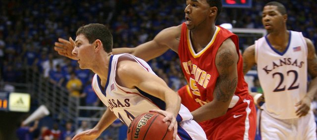 Kansas guard Tyrel Reed drives past Pittsburg State guard Brandon Coleman (5) during the first half Tuesday, Nov. 10, 2009 at Allen Fieldhouse.