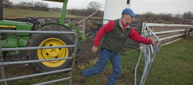 Tommy Hutchinson works on an area farm Tuesday morning. At age 27, Hutchinson, who served in the Navy Reserves in Iraq, is part of a new generation of military veterans.