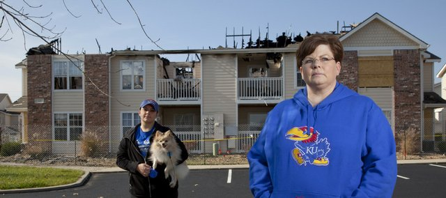 Jennifer Goode, with her dog Louie, left, and Kim Springer lost their apartments in the fire at Aberdeen South in October. Residents still haven't been allowed in the apartments to get personal items and other belongings.