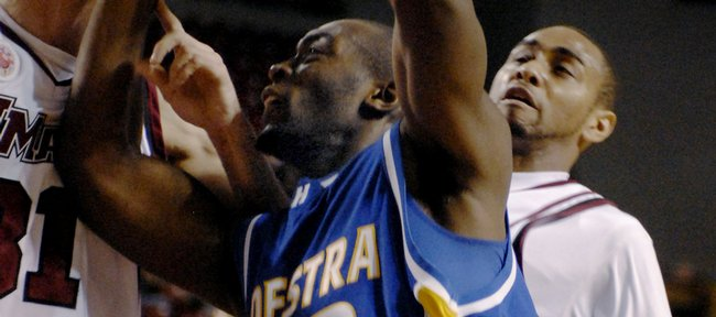 Hofstra's Charles Jenkins (22) drives against Massachusetts' Luke Bonner, left and Chris Lowe in the second half of an NCAA college basketball game in Amherst, Mass., Saturday, Dec. 20, 2008. UMass won 97-81.