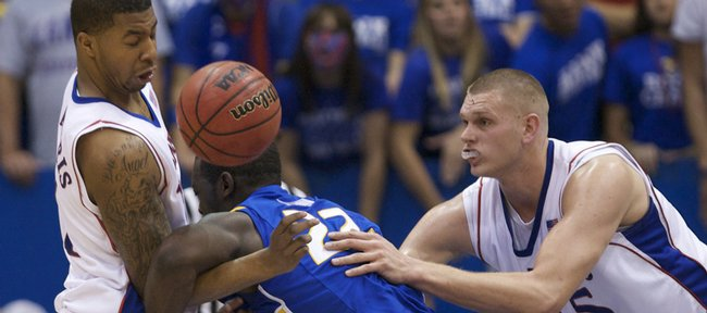 Kansas forward Markieff Morris pops the ball loose from Hofstra guard Charles Jenkins as center Cole Aldrich helps defend during the first half, Friday, Nov. 13, 2009 at Allen Fieldhouse.