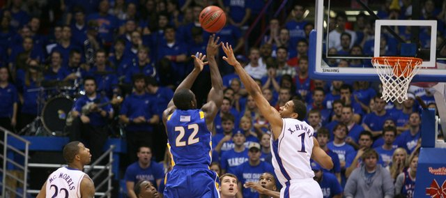 Kansas forward Xavier Henry defends a shot by Hofstra guard Charles Jenkins during the second half, Friday, Nov. 13, 2009 at Allen Fieldhouse.