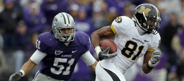 Missouri wide receiver Danario Alexander (81) gets away from Kansas State linebacker Ulla Pomele (51) as he runs the ball 80 yards for a touchdown during the third quarter Saturday, Nov. 14, 2009 in Manhattan, Kan. Missouri won the game 38-12