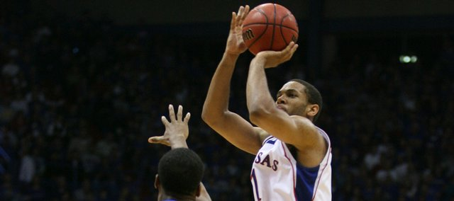 Kansas forward Xavier Henry elevates for a three-pointer over Hofstra guard Nathaniel Lester during the second half, Friday, Nov. 13, 2009 at Allen Fieldhouse. Henry scored 27 in his freshman debut.