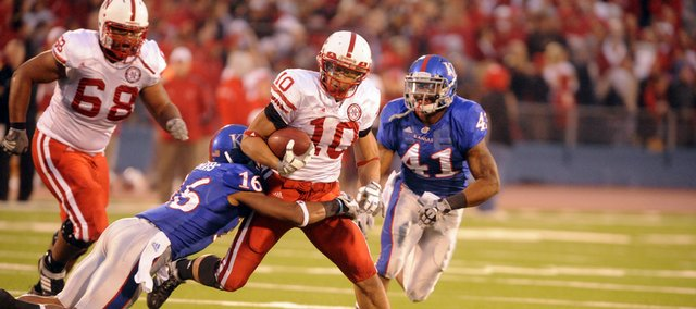 KU's Chris Harris tries to take down Nebraska running back Roy Helu Jr. Saturday, Nov. 14, 2009 at Memorial Stadium. Helu Jr. rumbled for over 100 yards and three touchdowns against the Jayhawks.