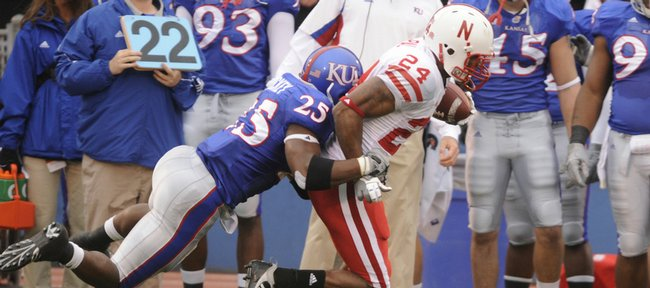 KU safety Darrell Stuckey tries to bring down Nebraska wide receiver Niles Paul in the first half of Saturday's game.