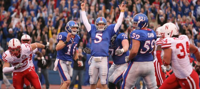 Kansas quarterback Todd Reesing throws up his hands in celebration after scoring a touchdown against Nebraska during the first half, Saturday, Nov. 14, 2009 at Memorial Stadium.