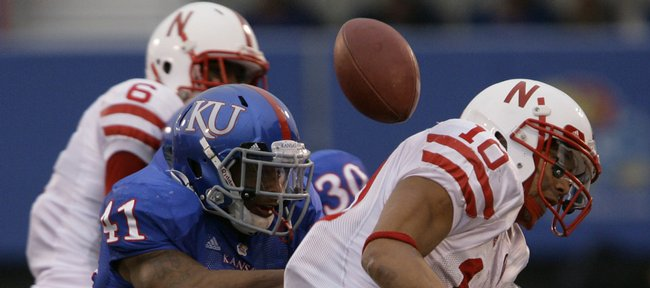 Kansas linebacker Arist Wright hits Nebraska running back Roy Helu Jr. as he bobbles the ball during the second quarter, Saturday, Nov. 14, 2009 at Memorial Stadium.