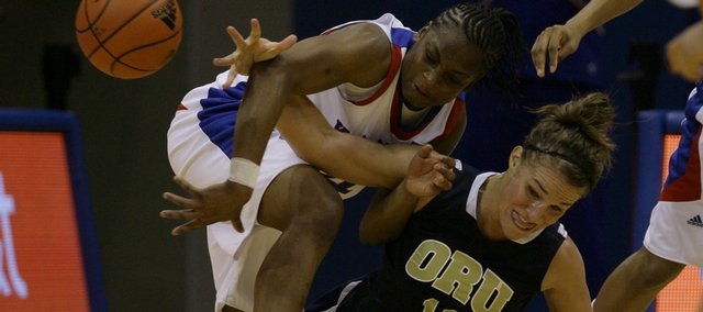 KU guard Danielle McCray (left) tries to get the loose ball away from Oral Roberts forward Janae Voelker (11)  in second half action during the women's basketball game Sunday, Nov. 15 against Kansas and Oral Roberts at Allen Fieldhouse.  KU won 106-80.