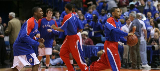Kansas guard C.J. Henry, right, and forward Thomas Robinson run a weave before tipping off against Memphis, Tuesday, Nov. 17, 2009 at the Scottrade Center in St. Louis.