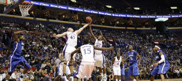 Kansas center Cole Aldrich and guard Tyshawn Taylor go up for a rebound against Memphis during the first half, Tuesday, Nov. 17, 2009 at the Scottrade Center in St. Louis.