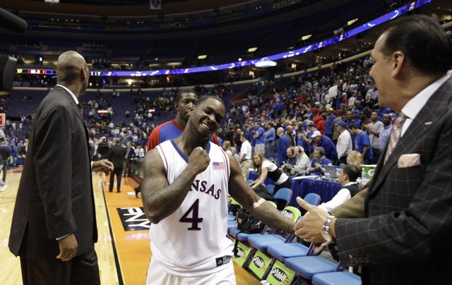 Kansas guard Sherron Collins pumps his fist as he exits the court following the Jayhawks 57-55 win over Memphis, Tuesday, Nov. 17, 2009 at the Scottrade Center in St. Louis.