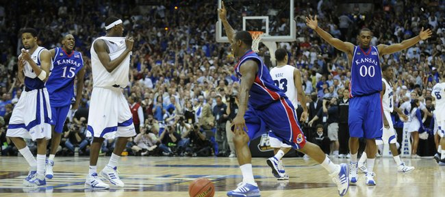 Kansas guard Sherron Collins, center, celebrates with Mario Chalmers (15) and Darrell Arthur (00) after the Jayhawks defeated Memphis in the national championship game on April 7, 2008, in San Antonio. KU and Memphis meet tonight for the first time since the title game.