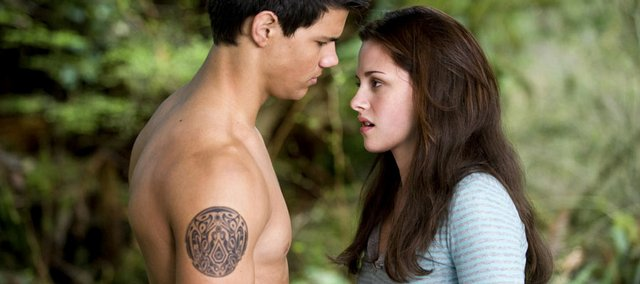 "Taylor Lautner and Kristen Stewart star in ""The Twilight Saga: New Moon."""
