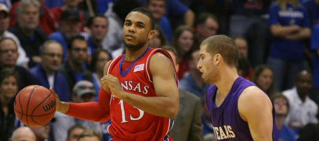 Kansas guard C.J. Henry drives past Central Arkansas guard Imad Qahwash during the first half, Thursday, Nov. 19, 2009 at Allen Fieldhouse.