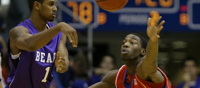 Kansas guard Elijah Johnson defends against the pass from Central Arkansas guard Ryan Daniels during the second half, Thursday, Nov. 19, 2009 at Allen Fieldhouse.