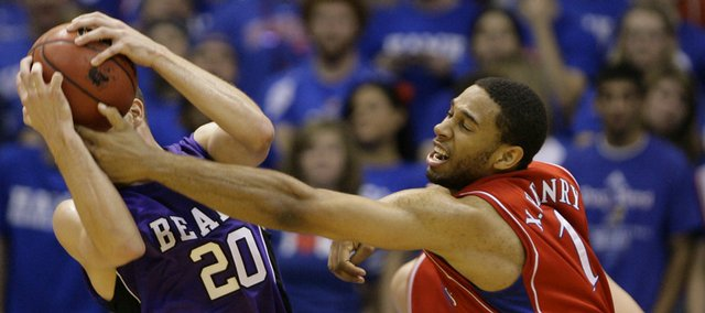Kansas guard Xavier Henry reaches for a steal against Central Arkansas guard Imad Qahwash during the second half, Thursday, Nov. 19, 2009 at Allen Fieldhouse.