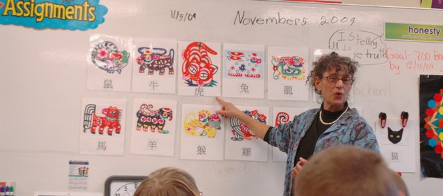"""Randi Hacker, outreach coordinator at Kansas University's Center for East Asian Studies, teaches Eudora Elementary School instructor Staci Mann's third-grade class how to pronounce the names of the Chinese New Year birth animals. The lesson was part of a """"Five Days of Chinese"""" outreach program."""