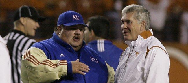 Kansas University head football coach Mark Mangino speaks with Texas head coach Mack Brown before kickoff Saturday, Nov. 21, 2009 at Darrell K. Royal-Texas Memorial Stadium.