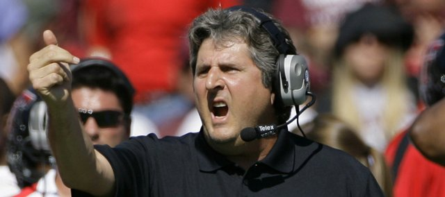 Texas Tech coach Mike Leach directs his team against Texas A&M in this file photo from Oct. 18 in College Station, Texas.