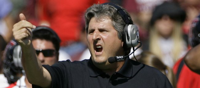 Texas Tech coach Mike Leach directs his team against Texas A&amp;M in this file photo from Oct. 18 in College Station, Texas.