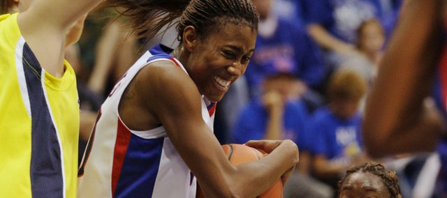 KU senior guard Sade Morris fights her way into the lane against the Michigan defense during the game on Sunday, Nov. 22, 2009, at Allen Fieldhouse.
