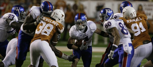Kansas running back Jake Sharp looks for a hole during the first quarter Saturday, Nov. 21, 2009 at Darrell K. Royal-Texas Memorial Stadium.