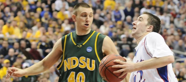 Kansas guard Brady Morningstar charges past North Dakota State center Lucas Moorman for a bucket during the second half Friday, March 20, 2009 at the Metrodome in Minneapolis.