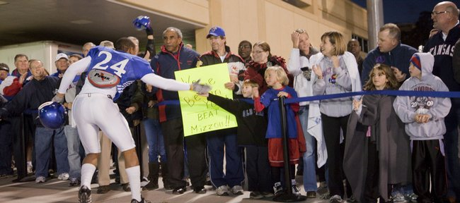 Kansas University wide receiver Bradley McDougald greets fans who showed up after practice to show their support for the Jayhawks. About 150 fans turned out Wednesday.