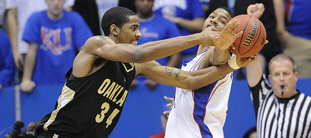 KU's Markieff Morris fights against Oakland's Keith Benson for the ball Wednesday, Nov. 25, 2009 at Allen Fieldhouse.