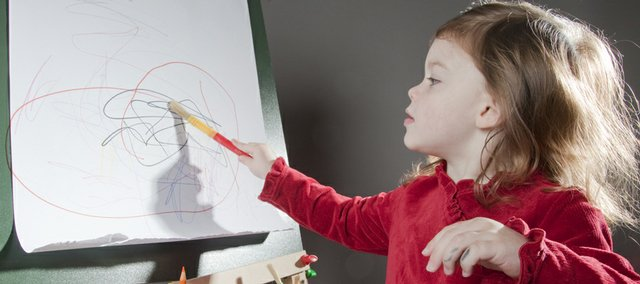 Ava Kohart, 2,  of Eudora, doodles on the Melissa & Doug Deluxe Standing Easel. She is the daughter of Chris and Marie Kohart of Eudora.
