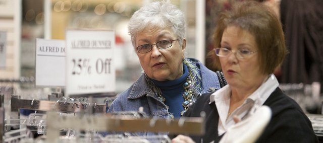 Store manager Janet Mihalchik, right, assists Lawrence resident Mary Beth Harmon as she shops for a Christmas present for her mother-in-law Wednesday at Weaver's Department Store, 901 Mass.