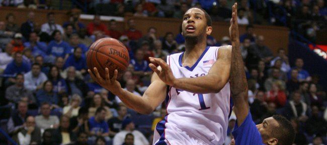 Kansas forward Xavier Henry elevates for a bucket against Memphis guard Doneal Mack during the Jayhawks' victory on Nov. 17 in St. Louis. Henry is averaging 17.3 points per game.